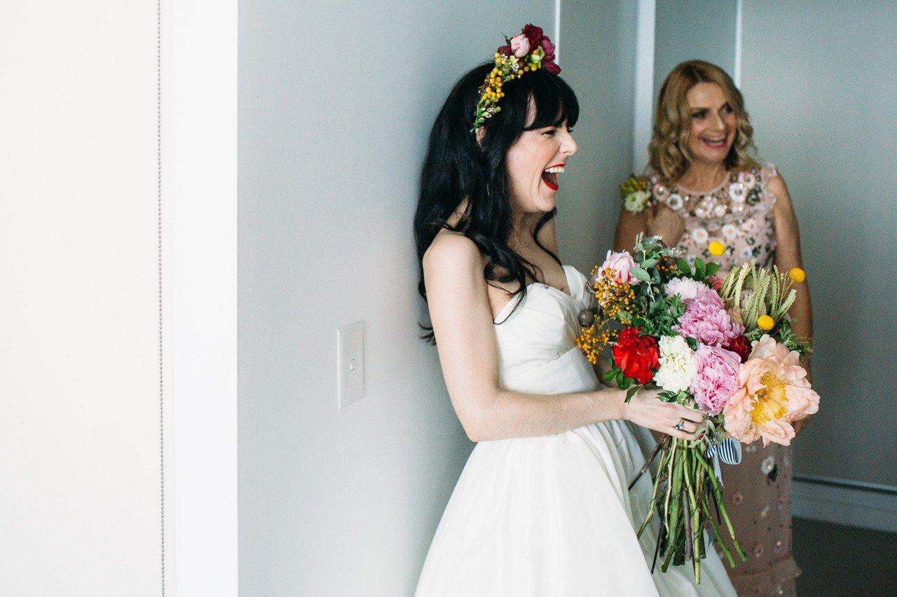 Happy bride with flowers by Brisbane wedding photographer