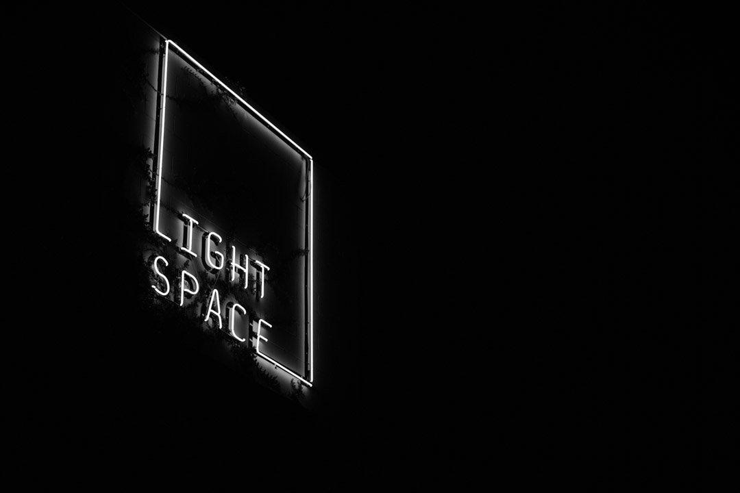 Lightspace wedding venue signage at night