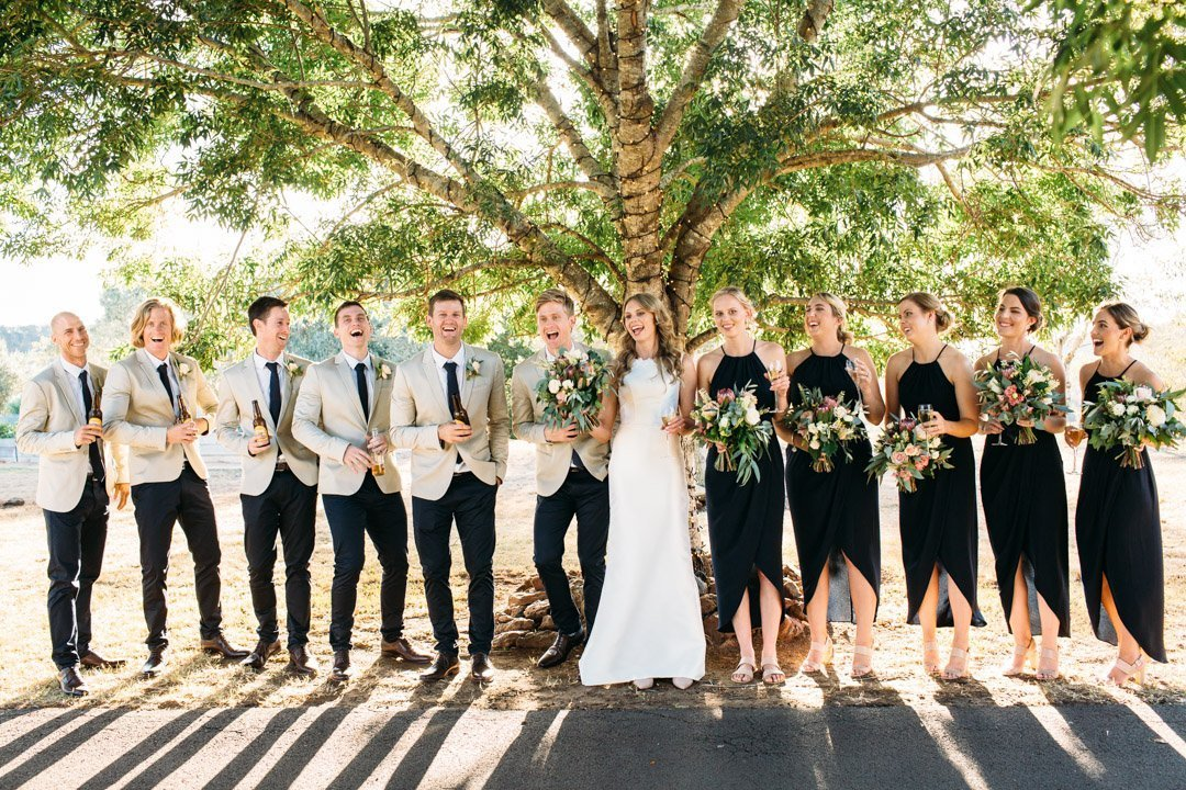 Whole bridal party laughing at Preston Peak Wedding