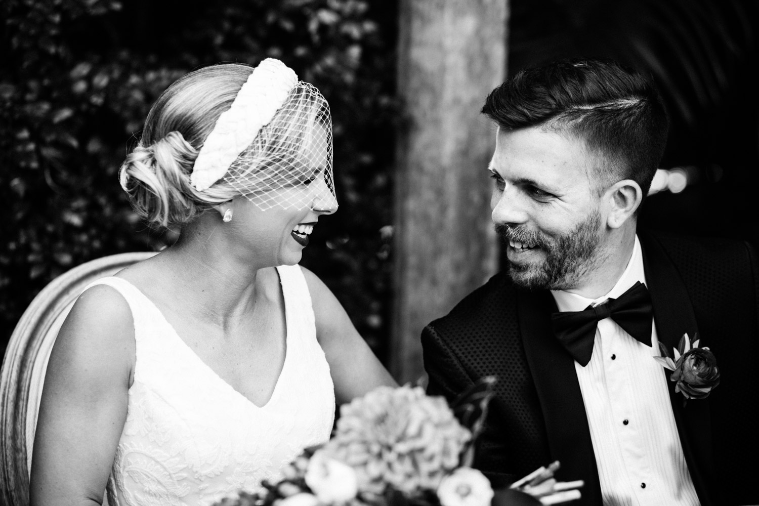 Bride and groom smiling at each other during Hillstone Wedding