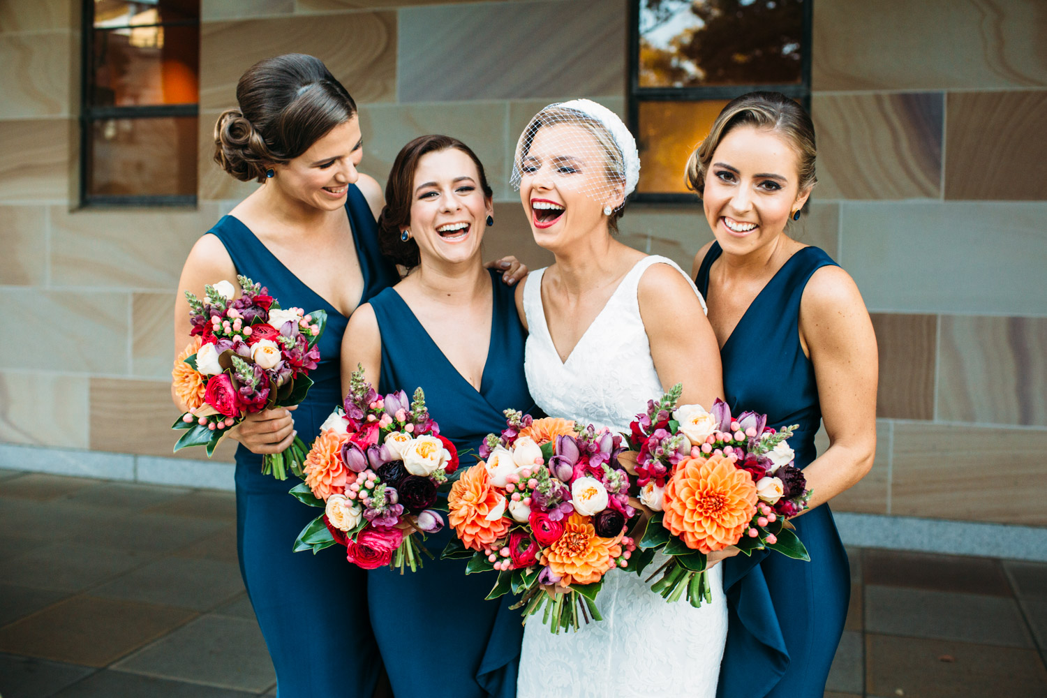 Bridesmaids laughing at UQ
