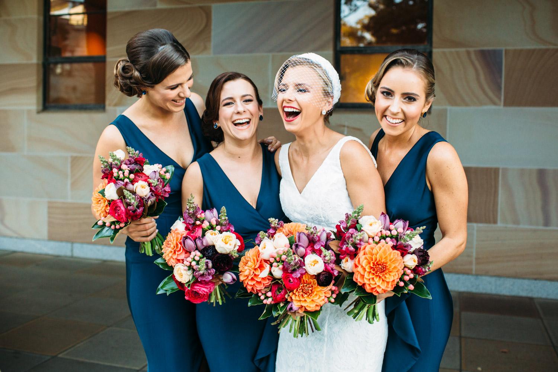 Bridesmaids laughing at UQ