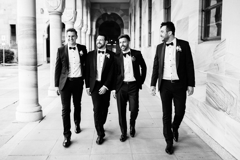 Groom and groomsmen walking at UQ