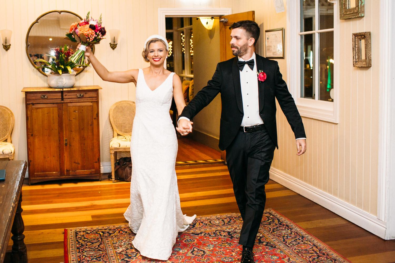 Bride and groom entering Hillstone Wedding reception