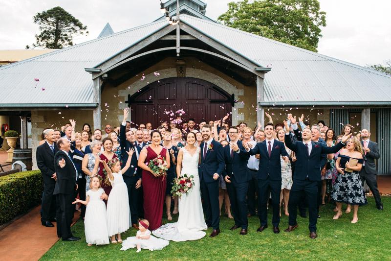 Flaxton Gardens wedding group shot with petal toss