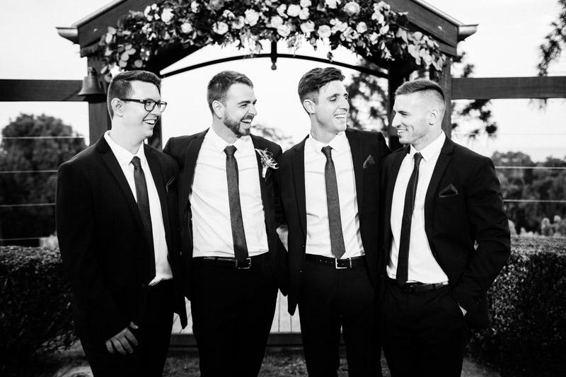 Groomsmen laughing at Flaxton Gardens wedding