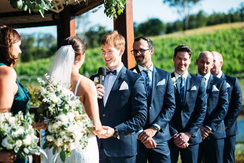Groom speaking during ceremony of Ocean View Estate wedding